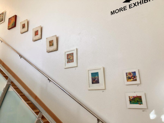 photo of pictures framed artistically along a staircase